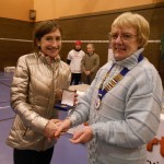 1st Lady Rebecca Robinson receives her medal from Northern Athletics President Jean Simpson