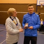 1st Man Derek Hawkins receives his medal from Northern Athletics President Jean Simpson