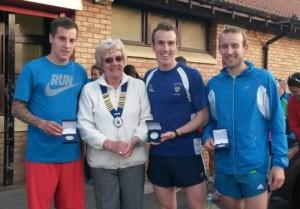 Morpeth Northern Athletics Men's team 5k Champion 2015 with Northern Athletics President Jean Simpson