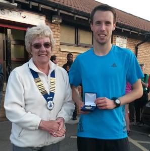 Carl Smith Northern Athletics 5k Champion 2015 with Northern Athletics President Jean Simpson