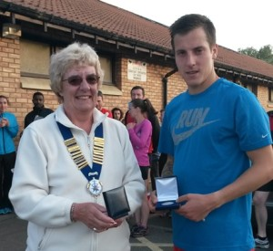 Lewis Timmins 2nd man with Northern Athletics President Jean Simpson