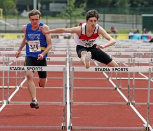 Jason Nicholson on route to winning the 100m hurdles after picking up the 400m hurdles title the previous day
