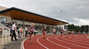 The under 13 girls 800m starts with the impressive new stand at Middlesbrough Sports Village in the background