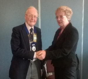 Dr Leo Carroll receives his president's chain of office from retiring president Jean Simpson MBE