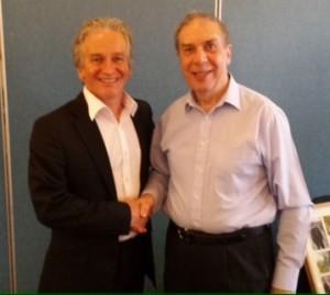 Retiring chairman Brian Heywood (right) and new Northern Athletics chairman Tony Wood