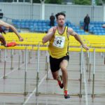 David Feeney (Amber Valley) wins the senior 110 metres hurdles.