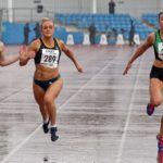 Annabelle Lewis (Kingston Upon Hull) wins the senior womens 100 metres from 343 Katy Wyper (Blackpool Wyre and Fylde) and Rebecca Campsall (City of York).