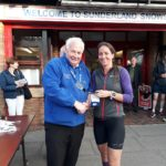Emma Holt winner of NA 2017 5k Road Running Championship with past NA President Bill McGuirk