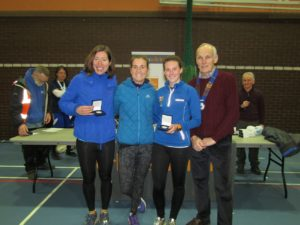 Blackburn Harriers wining ladies team with NA President Kevin Carr