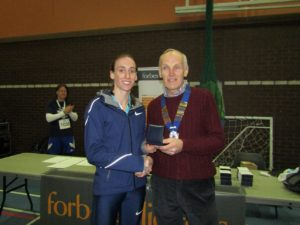 Laura Weightman NA 10k road running champion 2017 with NA President Kevin Carr