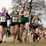 Leaders of the womens junior race, 49 Francesca Brint, eventual winner, 53 Juliet Downs, 51 Claudia Cowen (all Sale Harriers Manchester), and 8 Becky Briggs (City of Hull), 2018 Northern Cross Country Champs., Harewood House, Leeds. Photo: David T. Hewitson/Sports for All Pics