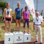 Senior women 400m hurdles 1st Abi Fitzpatrick, 2nd Anna Rowe, 3rd Nisha Desai with NA President Kevin Carr
