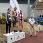 Under 20s women 200m 1st Niamh Emerson, 2nd Regan Walker, 3rd Stella Parrett with Kevin Carr