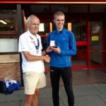 Sam Hancox NA 5k silver medal winner with Kevin Carr